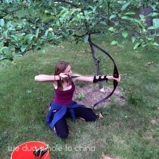 Annika kneeling archer